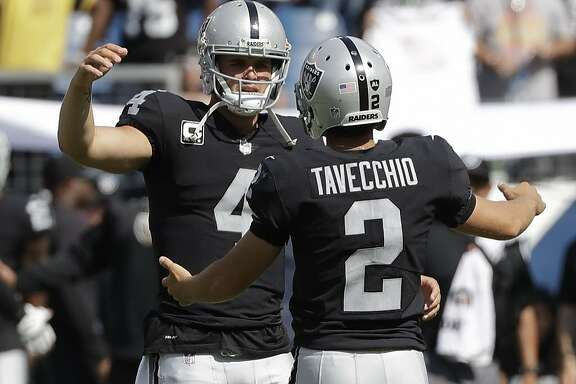 Oakland Raiders kicker Giorgio Tavecchio (2) celebrates with quarterback Derek Carr (4) after Tavecchio kicked a a 43-yard field goal against the Tennessee Titans in the fourth quarter of an NFL football game Sunday, Sept. 10, 2017, in Nashville, Tenn. The field goal was the fourth of the game for Tavecchio. The Raiders won 26-16. (AP Photo/James Kenney)
