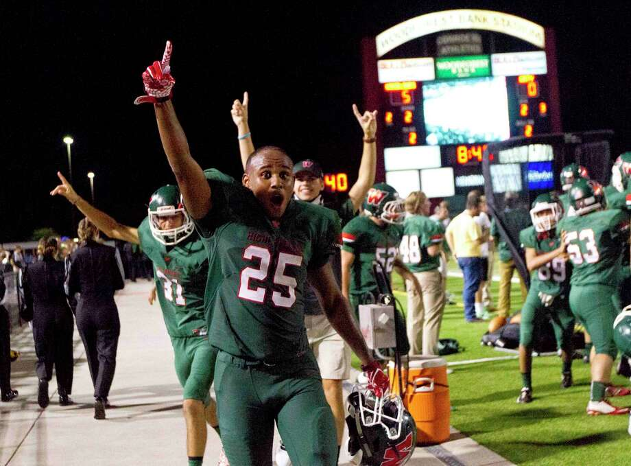 The Woodlands celebrate a turnover during last year's meeting against Katy at Woodforest Bank Stadium. Photo: Jason Fochtman, Staff / Jason Fochtman