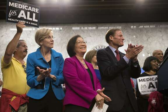 """Sens. Elizabeth Warren (D-Mass.), Mazie Hirono (D-Hawaii) and Richard Blumenthal (D-Conn.) look on as Sen. Bernie Sanders (I-Vt.) spoke at a news conference on health care policy, on Capitol Hill in Washington, Sept. 13, 2017. Sanders said that 15 Democratic senators have signed on to what he called a """"a Medicare-for-all, single-payer health care system."""" (Tom Brenner/The New York Times)"""