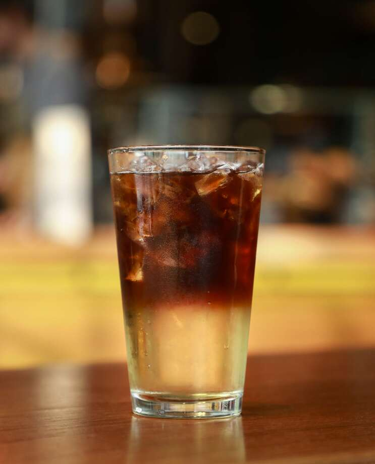 """The """"Cold-Pressed Ginger Fizz"""" which is: """"Ginger ale with a splash of whiskey barrel-aged vanilla syrup, a dash of grapefruit bitters, topped with cold-pressed espresso."""" Photo: Starbucks"""