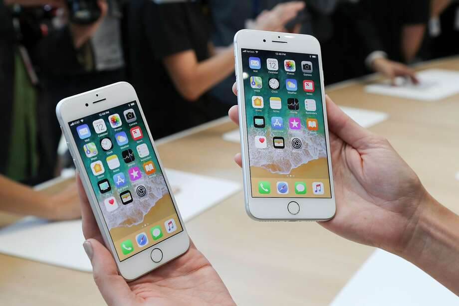 The iPhone 8 (left) and 8 Plus after Apple's product event at the new Steve Jobs Theater in Cupertino. Photo: JIM WILSON, NYT