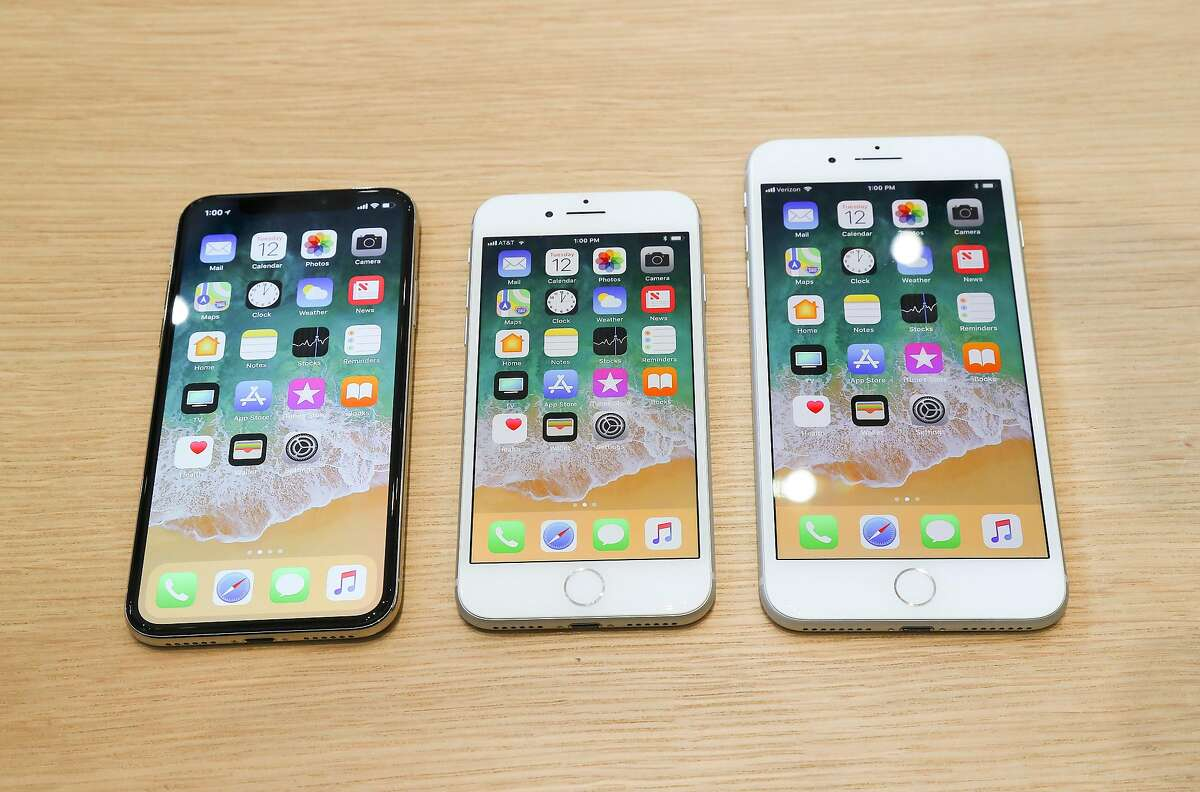 The new iPhones, from left, X, 8 and 8 Plus, after Apple's product event at the new Steve Jobs Theater in Cupertino, Calif., Sept. 12, 2017. (Jim Wilson/The New York Times)