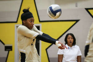 Conroe's Neena Brenson (2) digs the ball during the varsity volleyball game against Huffman Hargrave on Tuesday, Sept. 12, 2017, at Conroe High School. (Michael Minasi/ Chronicle)