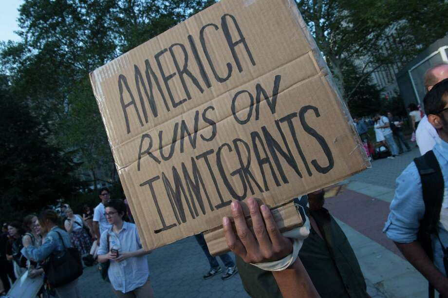 "Protesters hold signs at a rally to defend DACA on September 5, 2017 in New York. Getting rid of the more than 800,000 Dreamers is no way to put ""American first,"" a reader says. Photo: BRYAN R. SMITH /AFP /Getty Images / AFP or licensors"