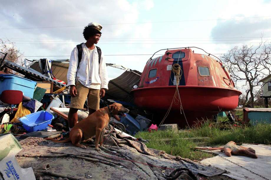 "In a Sept. 6, 2017 photo, Davonn Phothiboupha stands near a ""hurricane pod"" that he stayed in, bought by Linda Caster, a resident of Holiday Beach in Aransas County, Texas, as Hurricane Harvey made landfall. Three people and two dogs stayed inside the pod when Hurricane Harvey made its second landfall with 130 mph winds in Aransas County on Aug. 26. and Phothiboupha said it saved their lives. Photo: Rachel Denny Clow, Corpus Christi Caller Times / Corpus Christi Caller-Times"
