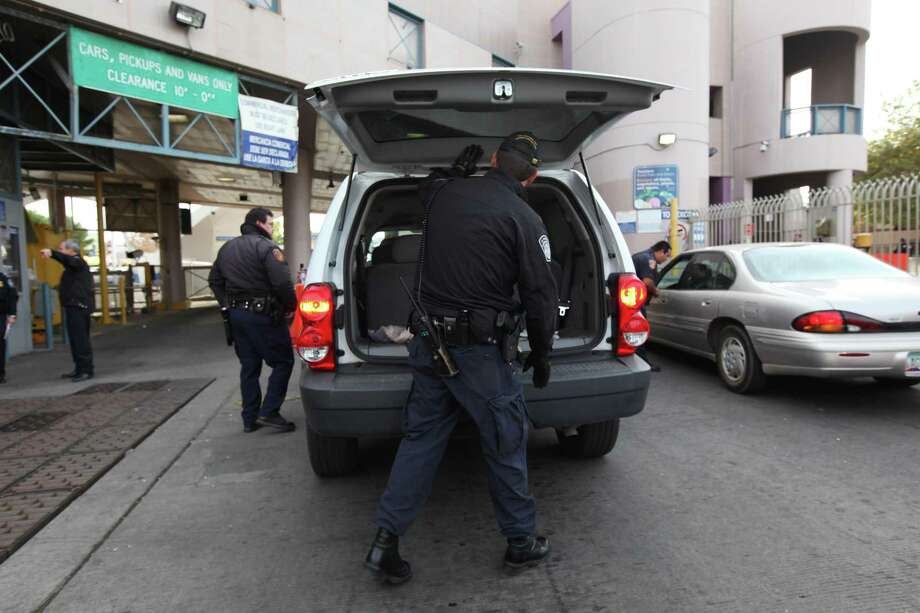 U.S. Customs and Border Patrol agents search a vehicle at the Nogales Border Station in Nogales, Ariz. A lawsuit filed by the American Civil Liberties Union and the Electronic Frontier Foundation on Wednesday argues that searches of phones and laptops at the border are in violation of the First and Fourth Amendments. Photo: New York Times File Photo / NYTNS