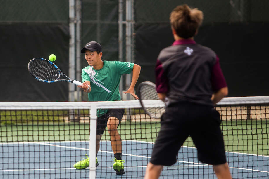 Dow senior Daniel Zhang, half of Dow's number 2 doubles pair, plays a pair from University of Detroit Jesuit during a tournament on Wednesday, September 13, 2017 at the Greater Midland Tennis Center. (Katy Kildee/kkildee@mdn.net) Photo: (Katy Kildee/kkildee@mdn.net)