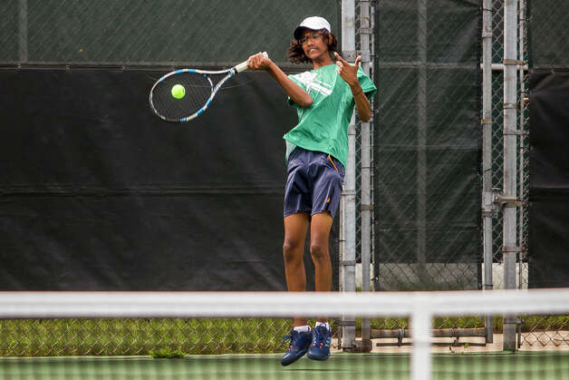 Dow senior Gopaul Parthasarathy, half of Dow's number 2 doubles pair, plays a pair from University of Detroit Jesuit during a tournament on Wednesday, September 13, 2017 at the Greater Midland Tennis Center. (Katy Kildee/kkildee@mdn.net) Photo: (Katy Kildee/kkildee@mdn.net)