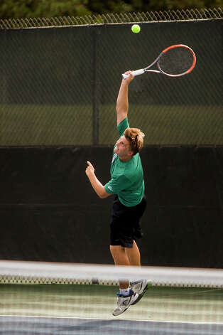 Dow junior Tyler Conrad, Dow's number 2 singles player, plays an athlete from University of Detroit Jesuit during a tournament on Wednesday, September 13, 2017 at the Greater Midland Tennis Center. (Katy Kildee/kkildee@mdn.net) Photo: (Katy Kildee/kkildee@mdn.net)