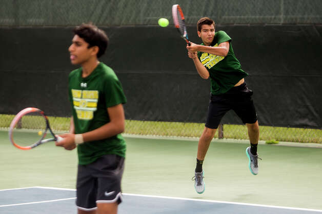 Dow senior Aditya Middha, right, and sophomore Saketh Kamaraju, left, Dow's number 1 doubles pair, plays a pair from University of Detroit Jesuit during a tournament on Wednesday, September 13, 2017 at the Greater Midland Tennis Center. (Katy Kildee/kkildee@mdn.net) Photo: (Katy Kildee/kkildee@mdn.net)
