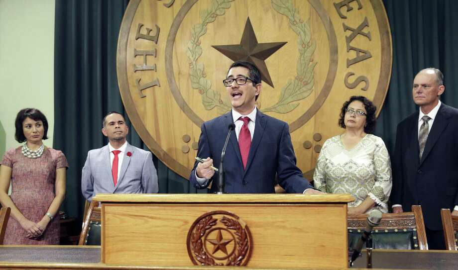 Jose Garza, representing the Workers Defense Action Fund, makes comments as members of the Mexican American Legislative Caucus speak at the Capitol stating their views of recent governmental action regarding DACA and SB4 in Texas on September 13, 2017. Photo: Tom Reel, Staff / San Antonio Express-News / 2017 SAN ANTONIO EXPRESS-NEWS