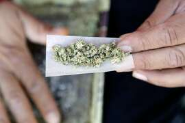 FILE - In this Nov. 9, 2016 file photo, a marijuana joint is rolled in San Francisco. On Monday, Feb. 27, 2017, the American Academy of Pediatrics is highlighting warnings about marijuana's potential harms for teens amid increasingly lax laws and attitudes on pot use. (AP Photo/Marcio Jose Sanchez, File)
