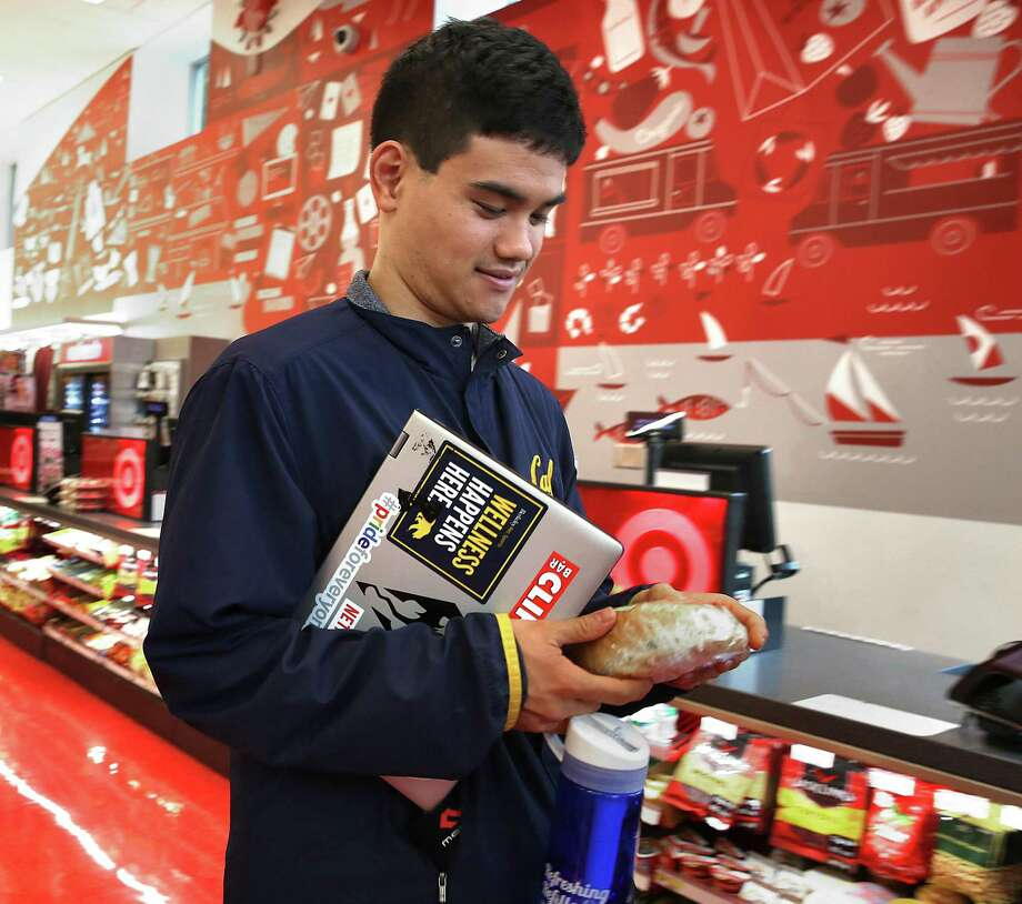 A student grabs a snack at Target on Shattuck Ave. near the UC Berkeley campus on Friday in Berkeley, Calif. Target looks to hire 100,000 for the holiday season, a 40 percent jump over last year. Photo: Liz Hafalia /San Francisco Chronicle / online_yes