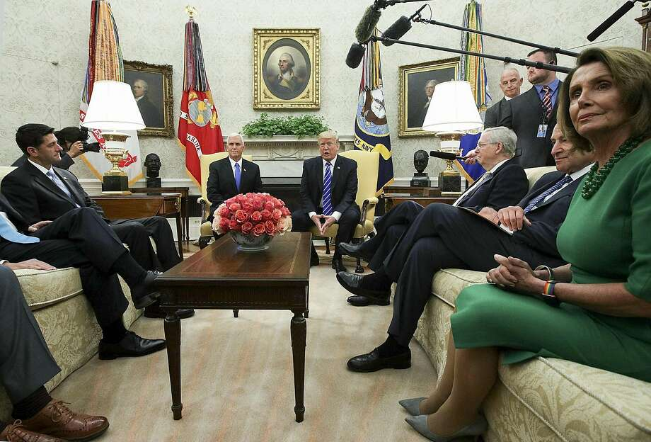 President Trump (center right) meets with congressional leaders and Vice President Mike Pence last week, revealing a deal with Democrats. Photo: Alex Wong, Bloomberg