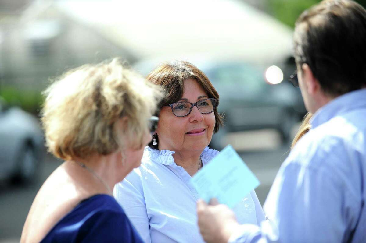 District 8 candidate Anabel Figueroa, a Democrat, listens to a voter outside a polling station during the primary election in Stamford on Tuesday.