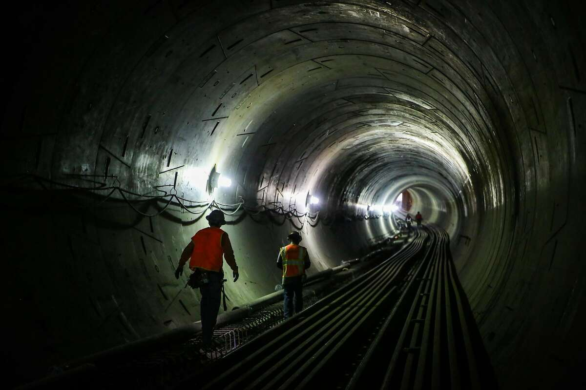 Workers walk through the central subway at the Moscone station in San Francisco, Calif., on Wednesday, Sept. 13, 2017.