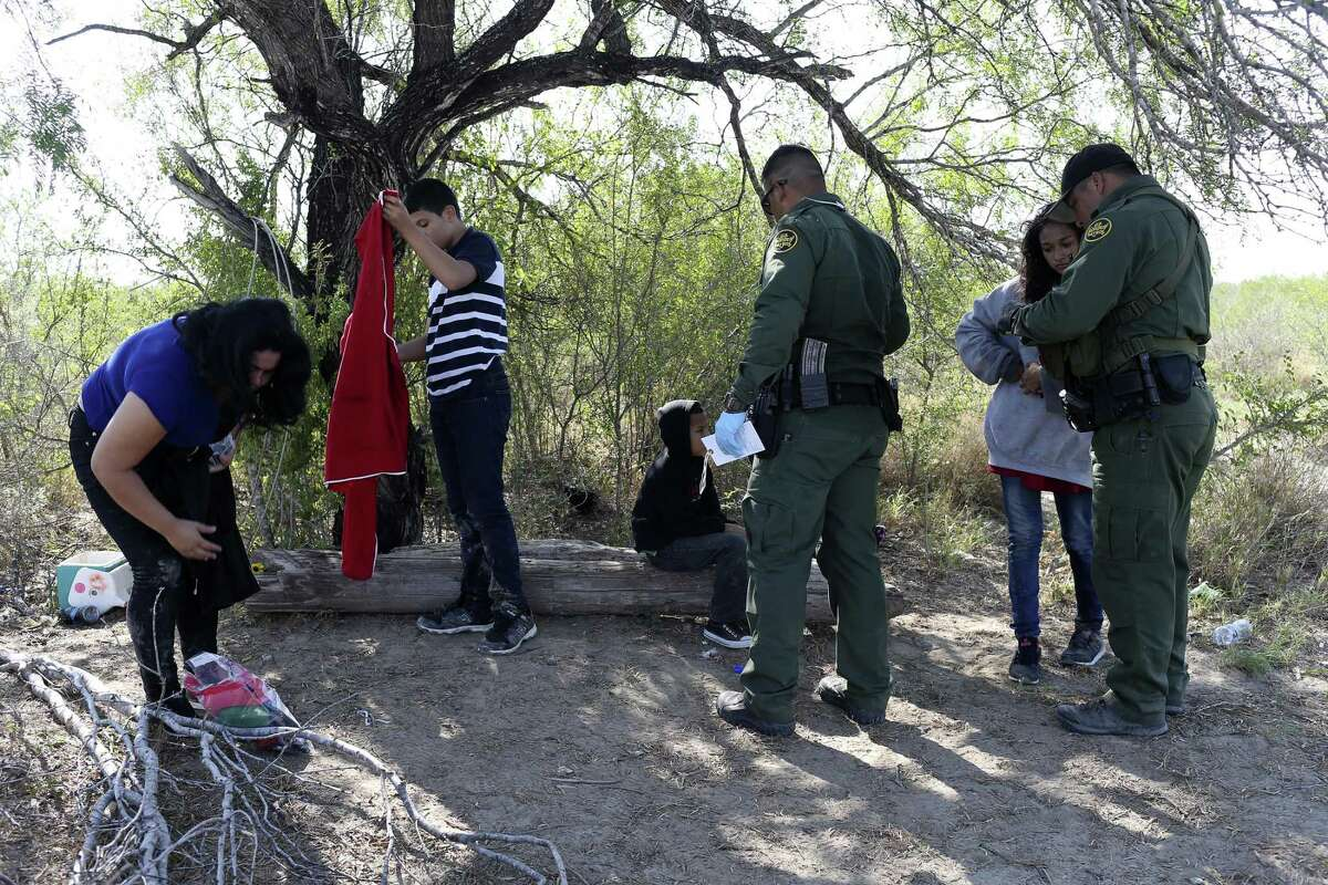 U.S. Border Patrol agents detain Central American families crossing into the U.S. in western Starr County, Tuesday, Sept. 12, 2017.