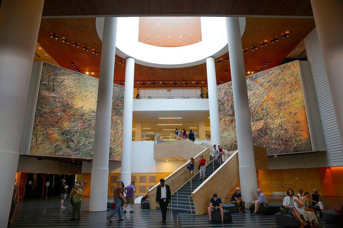 "Works by Julie Mehretu, titled ""Howl, eon ( I, II )"" 2017, hang in the lobby of the San Francisco Museum of Modern Art in San Francisco, Ca. on Fri. September 1, 2017."