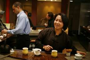 TEA24_244_cl.JPG Story on premium, whole leaf teas. Photo of Winnie Yu, right, at her tea house called Teance at 1780 Fourth Street, Berkeley, CA. Darius Maghaddiam, left, tea server at Teance. Event on 1/12/07 in Berkeley.  photo by Craig Lee / The Chronicle Ran on: 01-24-2007 At Teance in Berkeley, server Darius Maghaddiam invites Crystal Tokushige to inhale the scent of warmed tea leaves, while Linda Holsonback (middle right) and Patricia Ernsberger sip cups of brewed tea.
