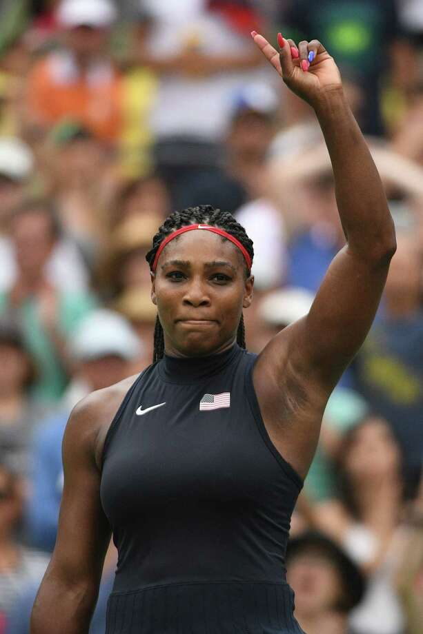 (FILES) This file photo taken on August 07, 2016 shows USA's Serena Williams react after winning her women's first round singles tennis match against Australia's Daria Gavrilova at the Olympic Tennis Centre of the Rio 2016 Olympic Games in Rio de Janeiro. Tennis superstar Serena Williams -- whose absence from women's tennis has shaken up the game -- has gone into labor at a clinic in West Palm Beach, Florida, local media reported on September 1, 2017. Williams, who will turn 36 later this week, was admitted Wednesday to St Mary's Medical Center, which shut down an entire floor to provide security for the megastar, the local CBS affiliate said. / AFP PHOTO / Roberto SCHMIDT / IMAGE RESTRICTED TO EDITORIAL USE - STRICTLY NO COMMERCIAL USEROBERTO SCHMIDT/AFP/Getty Images Photo: ROBERTO SCHMIDT / AFP or licensors