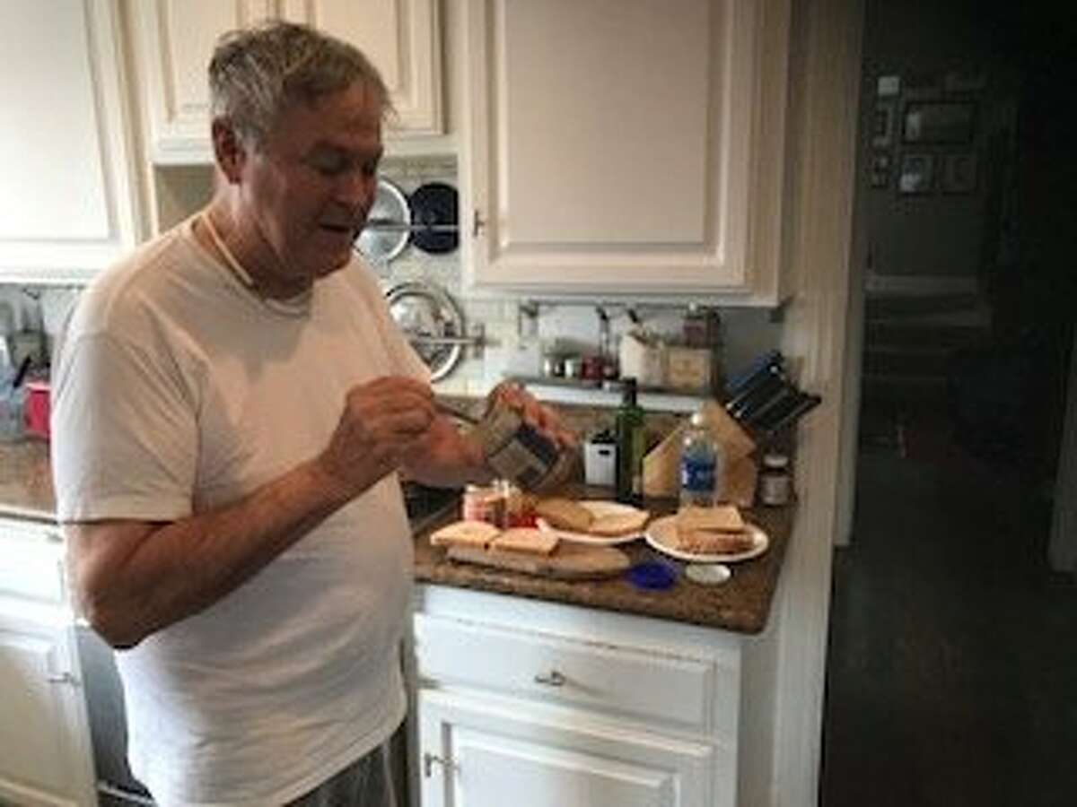 Rep. Dana Rohrabacher making a peanut-butter-and-jelly sandwich at his Costa Mesa home