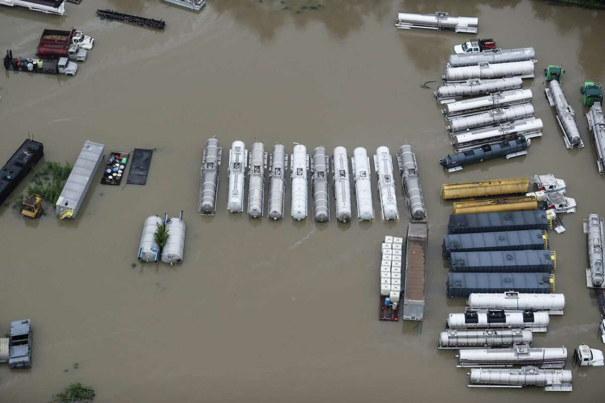 Industrial vehicles sit in floodwaters from Tropical Storm Harvey on Tuesday, Aug. 29, 2017, in Houston. ( Brett Coomer / Houston Chronicle )