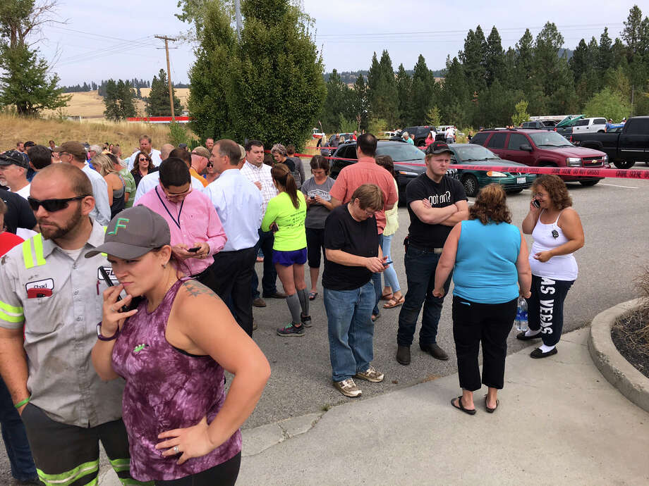 Parents gather in the parking lot behind Freeman High School in Rockford, Wash. to wait for their kids, after a deadly shooting at the high school Wednesday, Sept. 13, 2017. (Dan Pelle/The Spokesman-Review via AP) Photo: Dan Pelle, MBO / The Spokesman-Review