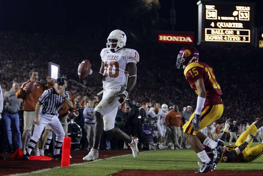 Vince Young scores the game-winning field goal in front of USC player Kevin Thomas in the second half Rose Bowl Wednesday, January 4, 2006 at Rose Bowl Stadium in Pasadena. The Longhorns won on a last-minute touchdown by Vince Young. BAHRAM MARK SOBHANI/STAFF
