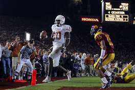 Vince Young scores the game-winning field goal in front of USC player Kevin Thomas in the second half Rose Bowl Wednesday, January 4, 2006 at Rose Bowl Stadium in Pasadena. The Longhorns won on a last-minute touchdown by Vince Young. BAHRAM MARK SOBHANI/STAFF TEXAS LONGHORNS SOUTHERN CALIFORNIA TROJANS USC NATIONAL CHAMPIONSHIP BCS
