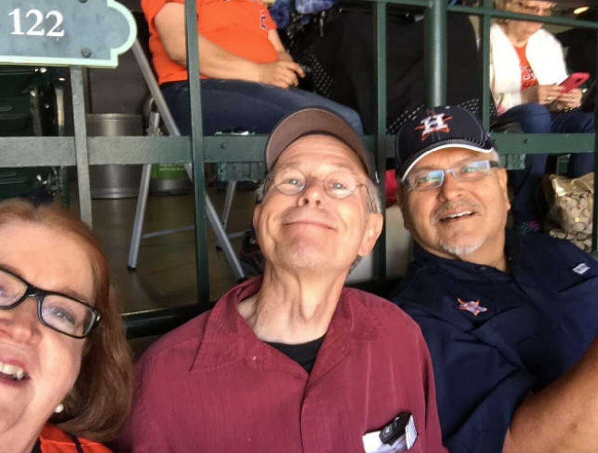 Jim Simmon, shown here at an Astros game this season, was found dead Tuesday.