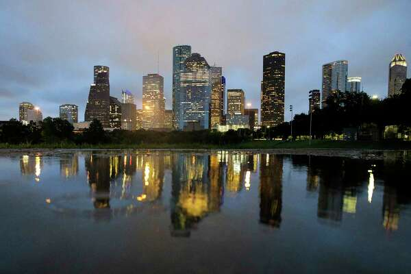 Houston's skyline as the sunsets the night that Hurricane Harvey is scheduled to make landfall on  Friday, Aug. 25, 2017. ( Elizabeth Conley / Houston Chronicle )
