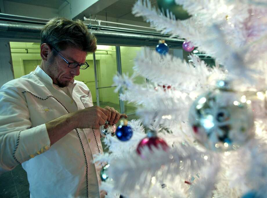 Chuck Ramirez works on a fanciful Christmas tree for client Linda Pace in 2006. The trees have been incorporated into McNay Art Museum's career survey of the artist, who died in 2010. Photo: Express-News File Photo / SAN ANTONIO EXPRESS-NEWS