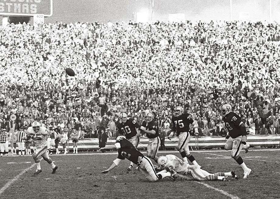 Quarterback Ken Stabler (on his knees) gets off the game-winning touchdown pass against the Miami Dolphins in the final quarter of Dec. 21, 1974 playoff game in Oakland. The pass, caught by Clarence Davis, not shown, gave the Raiders a 28 to 26 win. (AP photo/stf) Photo: ASSOCIATED PRESS / AP1974