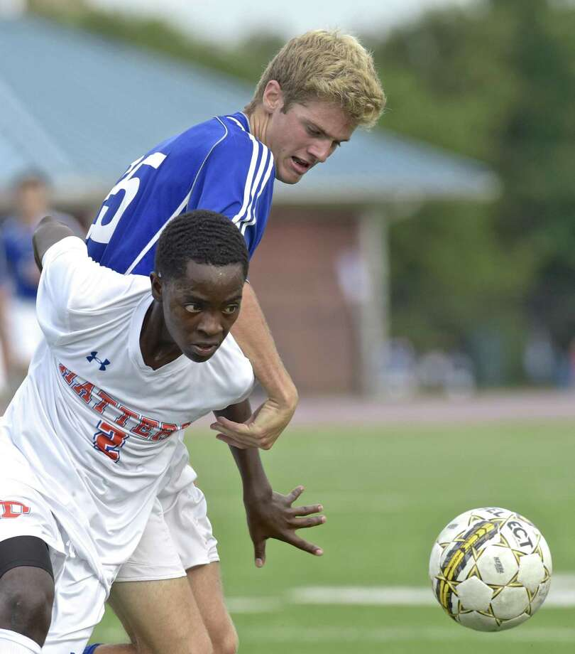 Danbury's Brandon Tyndale (2) and Ludlow's William Ryan Burress (25) fight for the ball in the boys varsity soccer game between Fairfield Ludlow and Danbury high schools, on Wednesday afternoon, September 13, 2017, at Danbury High School, in Danbury, Conn. Photo: H John Voorhees III / Hearst Connecticut Media / The News-Times
