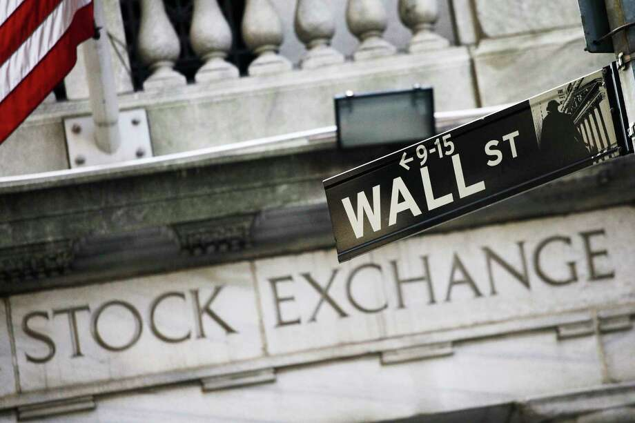FILE - This July 16, 2013, file photo, shows a Wall Street street sign outside the New York Stock Exchange. U.S. stocks are barely lower early Wednesday, Sept. 13, 2017, as banks and technology companies give back some of their gains from earlier in the week. Apple continues to take small losses as investors contemplate its new lineup of iPhones and other products. Energy companies and retailers are trading higher. (AP Photo/Mark Lennihan, File) Photo: Mark Lennihan, STF / Copyright 2016 The Associated Press. All rights reserved. This material may not be published, broadcast, rewritten or redistribu