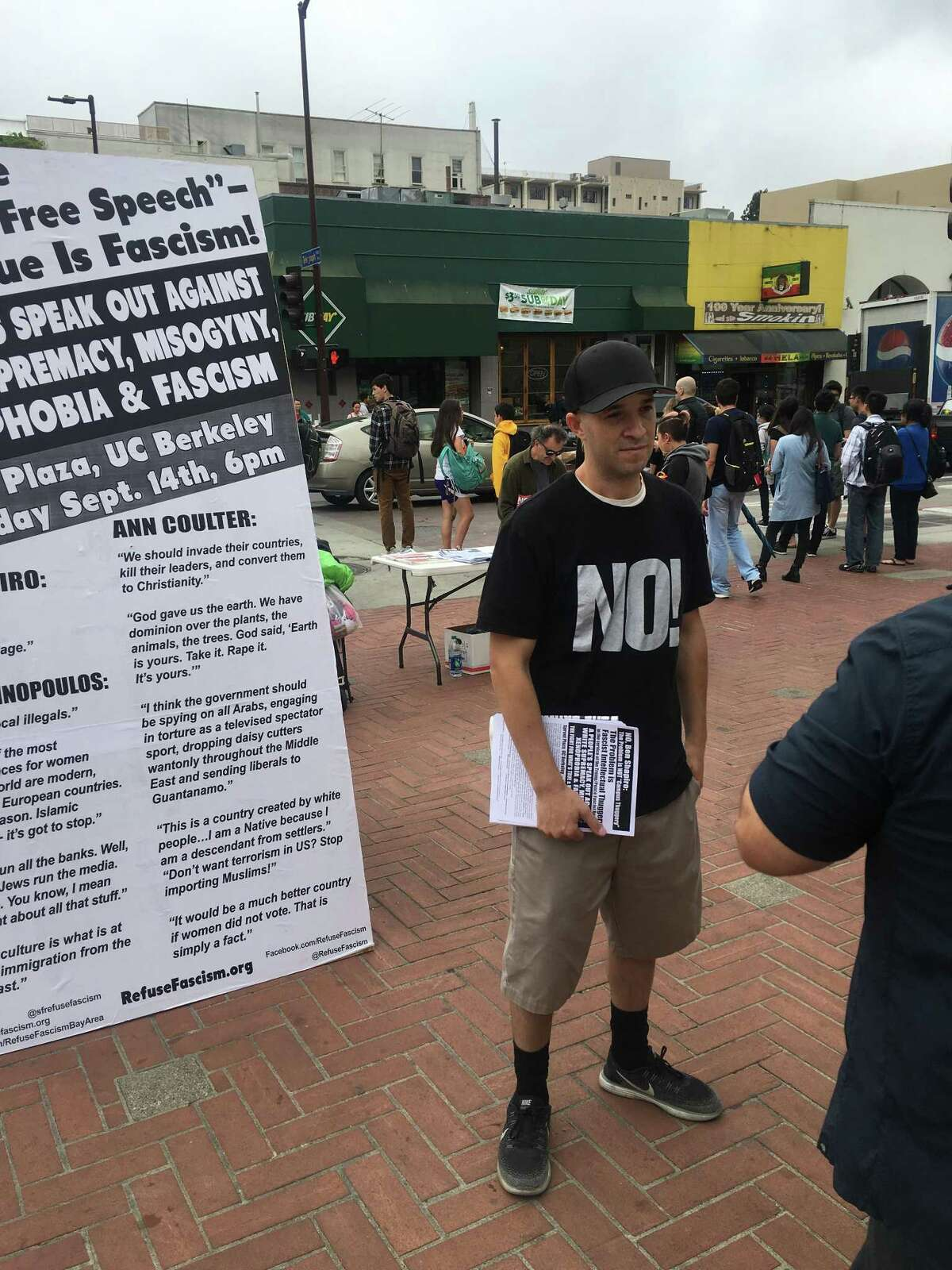 An unidentified critic of Ben Shapiro passes out posters s a day before the conservative commentator is scheduled to speak on campus on Wednesday September 13, 2017 in Berkeley.