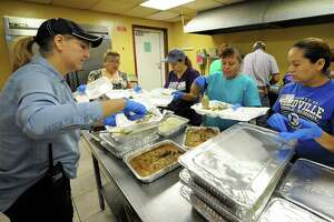 Volunteers prepare hot meals to be distributed to flood victims at Our Lady of Guadalupe Church in Rosenberg, TX on September 7, 2017.