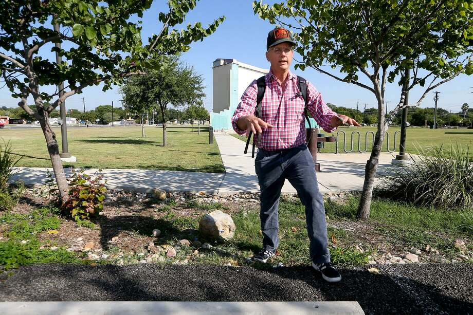 Brian Zabcik with Environment Texas talks about a rain gardens and bioswales, while standing on the edge of a bioswale bordering the parking lot at Mission Branch Library, during a tour of several green infrastructure features there on Sept. 12. Bioswales are designed to manage runoff from large areas such as parking lots and consist of engineered soils and plants. Photo: Marvin Pfeiffer /San Antonio Express-News / Express-News 2017