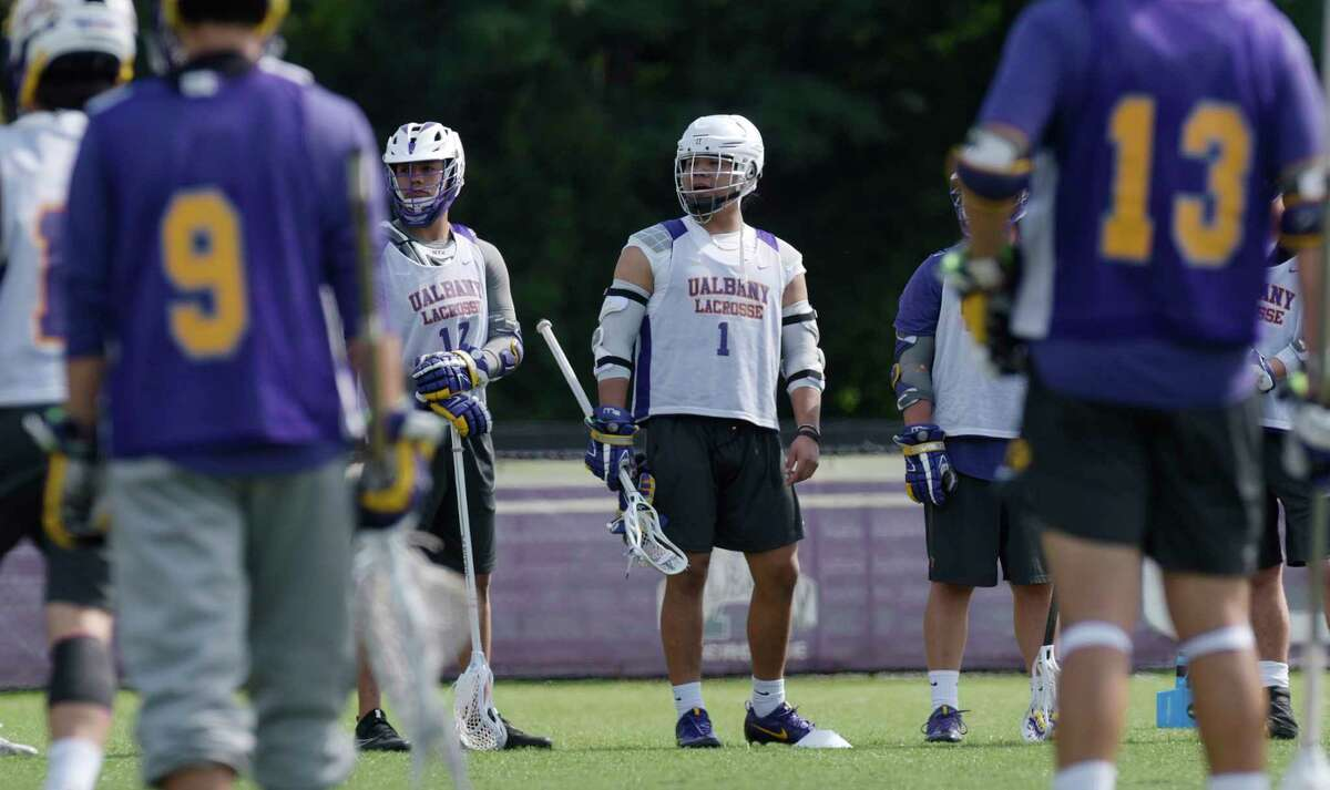 University at Albany men's lacrosse player, Tehoka Nanticoke, center, waits to take part in a drill during practice on Wednesday, Sept. 13, 2017, in Albany, N.Y. (Paul Buckowski / Times Union)