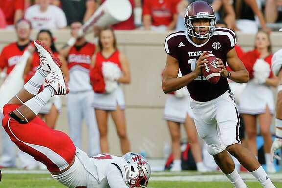 COLLEGE STATION, TX - SEPTEMBER 09:  Kellen Mond #11 of the Texas A&M Aggies scrambles out of the pocket to avoid a tackle by Terrell Encalade #87 of the Nicholls State Colonels in the second quarter at Kyle Field on September 9, 2017 in College Station, Texas.  (Photo by Bob Levey/Getty Images)