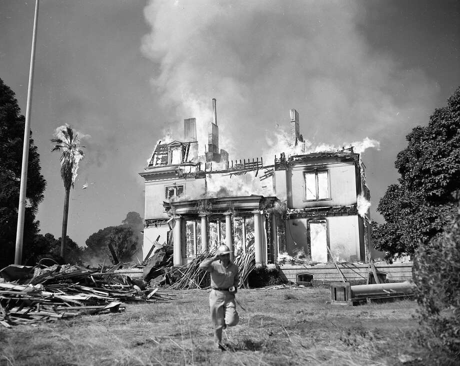 A fire destroys the historic Mills mansion on June 23, 1954. Photo: Bob Campbell, The Chronicle