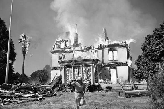 Fire destroys the Mills Estate, the home of Darius Mills, June 23,1954