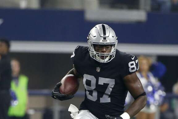 Oakland Raiders tight end Jared Cook (87) finds running room after catching a pass in the first half of a preseason NFL football game against the Dallas Cowboys on Saturday, Aug. 26, 2017, in Arlington, Texas. (AP Photo/Michael Ainsworth)