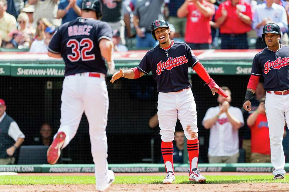 CLEVELAND, OH - SEPTEMBER 13: Francisco Lindor #12 waits to celebrate with Jay Bruce #32 of the Cleveland Indians after both scored during the first inning on a home run by Bruce at Progressive Field on September 13, 2017 in Cleveland, Ohio. (Photo by Jason Miller/Getty Images) ORG XMIT: 700012436 Photo: Jason Miller / 2017 Getty Images