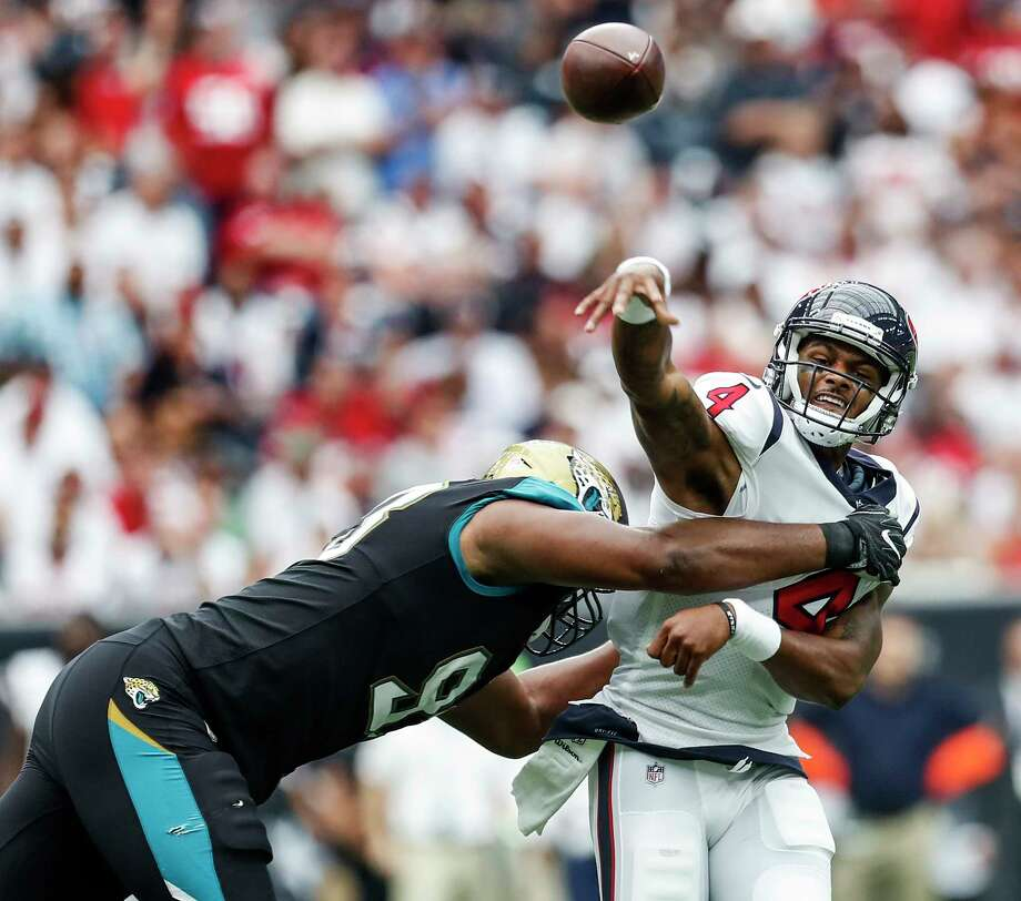 Thanks to the Texans' porous offensive line, Deshaun Watson was draped in Jaguars defenders upon making his regular-season debut. Photo: Brett Coomer, Staff / Internal