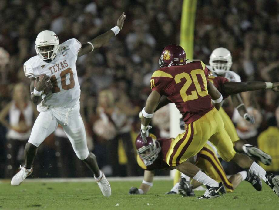 Eleven years after Vince Young's virtuoso performance for the ages to win the 2005 national title, Texas and USC will meet again Saturday in Los Angeles. Photo: BRETT COOMER, STAFF / Houston Chronicle