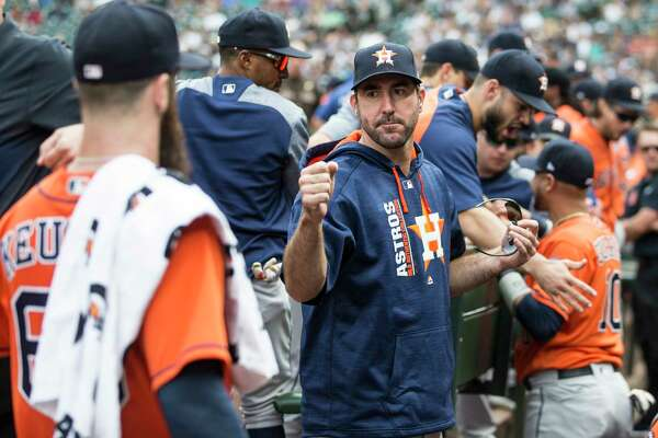 SEATTLE, WA - SEPTEMBER 4: Justin Verlander #35 of the Houston Astros greets starting pitcher Dallas Keuchel #60 of the Houston Astros in the dugout before a game against the Seattle Mariners at Safeco Field on September 4, 2017 in Seattle, Washington. (Photo by Stephen Brashear/Getty Images)