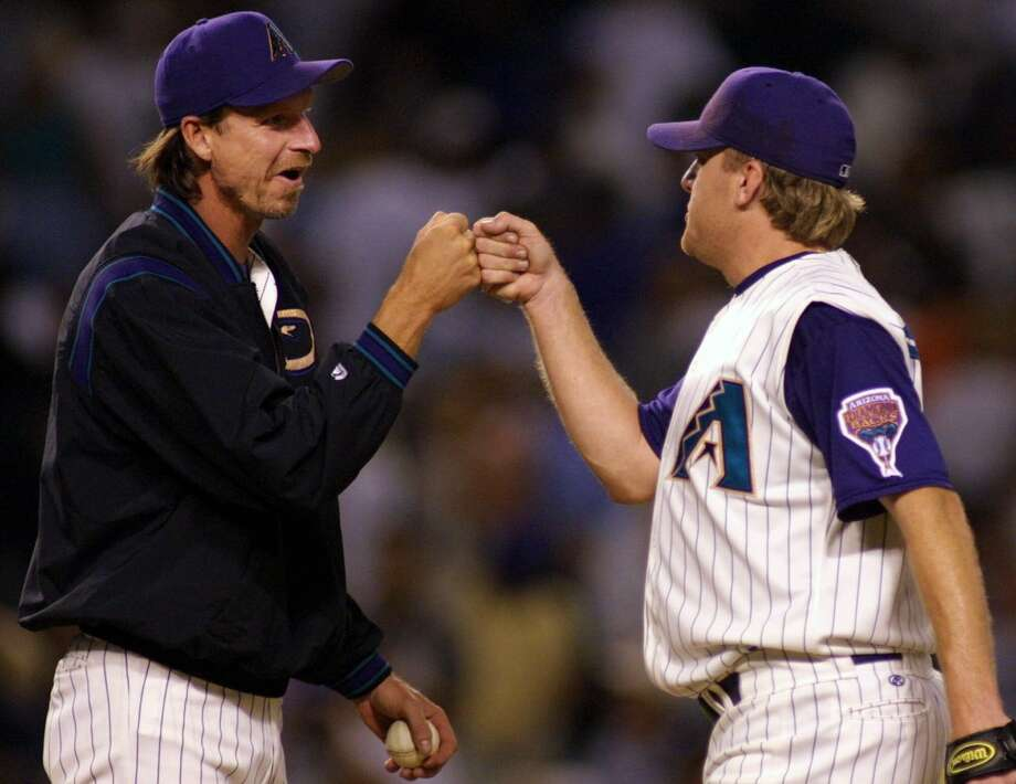 The Diamondbacks rode the arms of Randy Johnson, left, and Curt Schilling to a championship in 2001, with the two sharing World Series MVP honors. Photo: MIKE FIALA, STR / AP