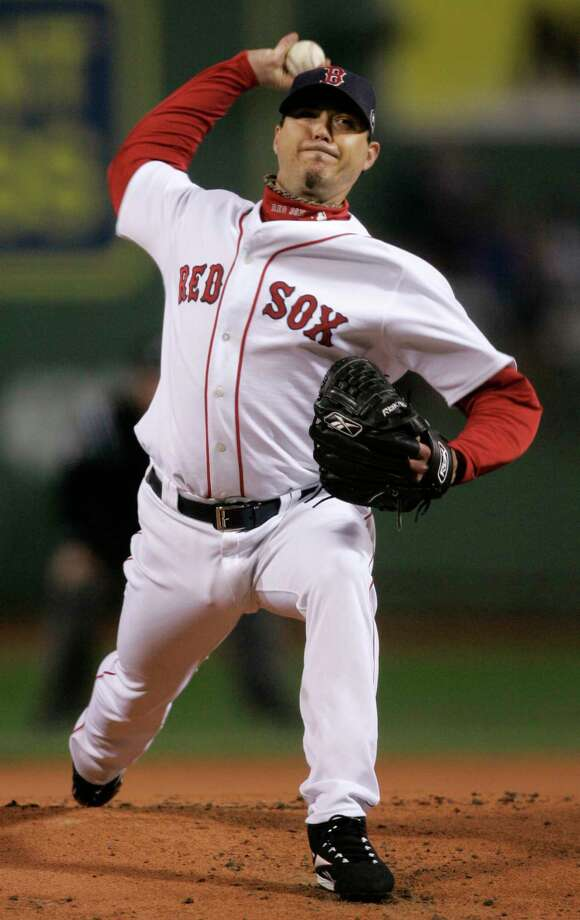 Josh Beckett, above, teamed with Curt Schilling, far right, to bring home a Red Sox championship in 1997. Randy Johnson, far left, was Schilling's running mate in helping the Diamondbacks win it all in 2001, their fourth season as a franchise. Photo: Elise Amendola, POOL / 2007 AP