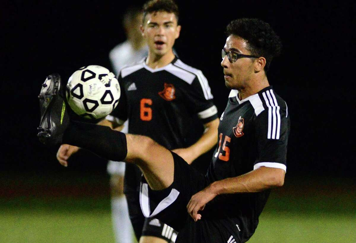 Stamford's Ali Essallamy high kicks the ball during action against Trumbull on Wednesday.